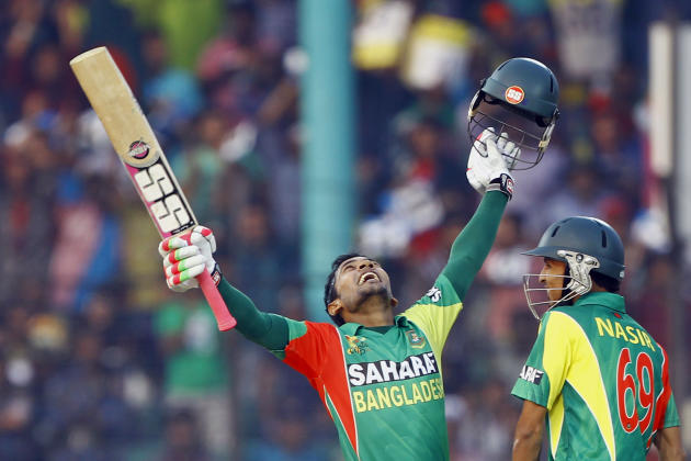 Bangladesh's Mushfiqur Rahim, left, celebrates after scoring a century, as Nasir Hossain smiles during the Asia Cup one-day international cricket tournament against India in Fatullah, near Dhaka,