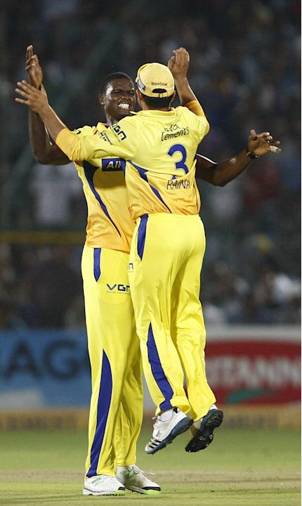 JO Holder and Suresh Raina celebrate after fall of a wicket during the CLT20 1st Semi-Final between Rajasthan Royals and Chennai Super Kings at Sawai Mansingh Stadium in Jaipur on Oct. 4, 2013.