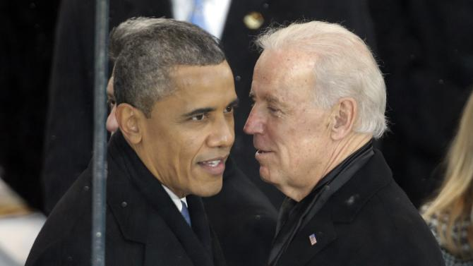 President Barack Obama, left, and Vice President Joe Biden talk inside the presidential box during the Inaugural parade, Monday, Jan. 21, 2013, in Washington. Thousands  marched during the 57th Presidential Inauguration parade after the ceremonial swearing-in of President Barack Obama. (AP Photo/Gerald Herbert)