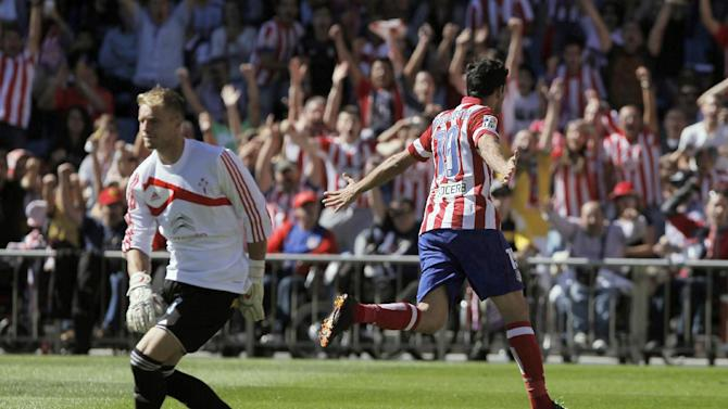 Atletico de Madrid's Diego Costa from Brazil, right, celebrates his goal as Celta de Vigo's Yoel, left, looks back during a Spanish La Liga soccer match at the Vicente Calderon stadium in Madrid, Spain, Sunday, Oct 6, 2013