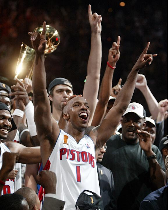 FILE - In this June 15, 2004, file photo, Detroit Pistons guard Chauncey Billups and teammates celebrate their 100-87 win over the Los Angeles Lakers for the NBA championship at the Palace of Auburn H