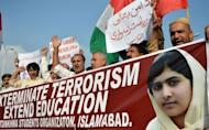 Pakistani demonstrators chant slogans during a protest against the assassination attempt by the Taliban on child activist Malala Yousafzai in Islamabad