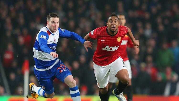 Anderson of Manchester United beats Danny Guthrie of Reading during the FA Cup Fifth Round match between Manchester United and Reading at Old Trafford on February 18, 2013 in Manchester, England.