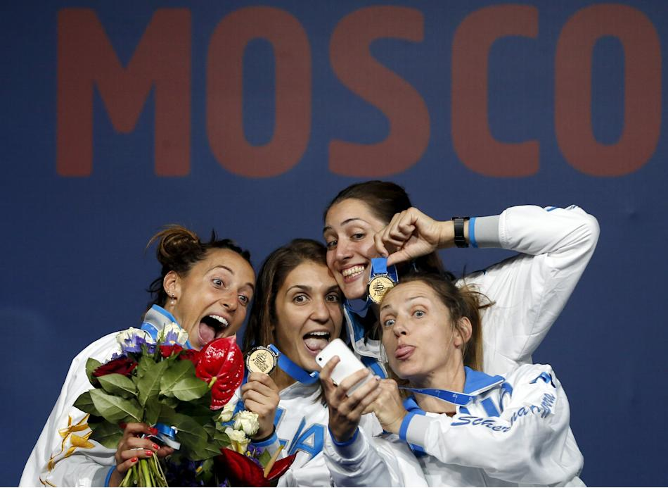 Winners of the women's team foil competition Italy's Di Francisca, Errigo, Batini and Valentina Vezzali pose for a picture during a medal ceremony at the World Fencing Championships in Moscow