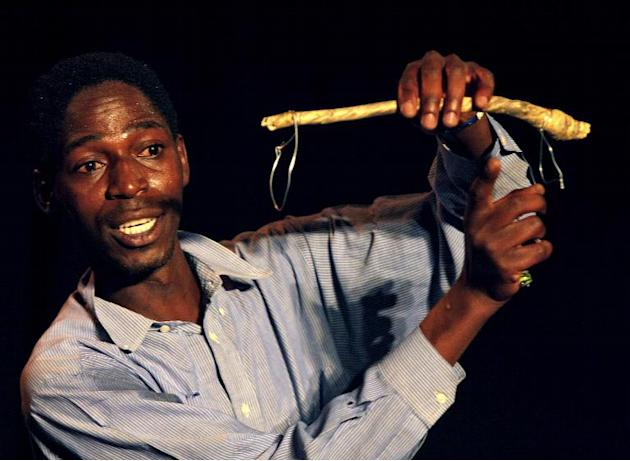 "Zimbabwean artist Jonathan Khumbulani Nkala performs in ""The Crossing"" at Harare International Festival of the Arts"