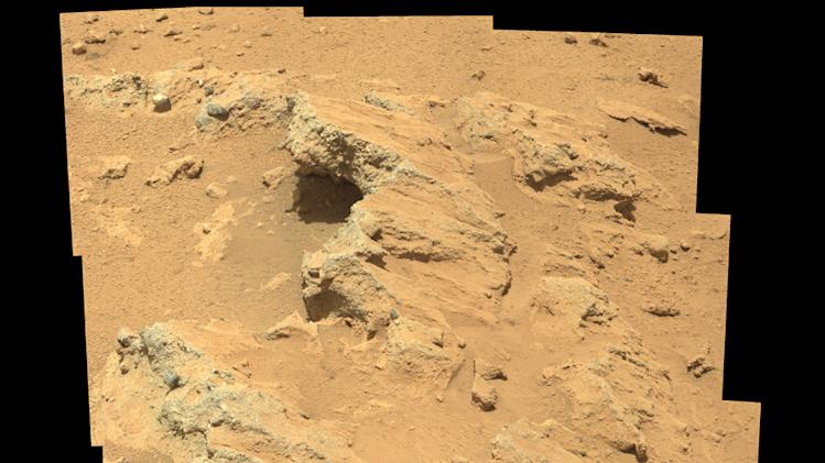 This image taken by the NASA rover Curiosity shows sediment at the bottom of an ancient streambed on Mars. Fresh analysis by Curiosity reveals hundreds of rounded pebbles in its Gale Crater landing site - a sign that a liquid once flowed there. (AP Photo/NASA)