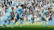 Manchester City's Edin Dzeko (R) runs back to the half-way line after scoring his goal during their English Premier League match against Queens Park Rangers at The Etihad stadium in Manchester, on May 13. Man City won the game 3-2 to secure their first league title since 1968