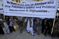 Afghan men hold an anti-Pakistan banner during a rally, protesting against Pakistan's interference in Afghanistan, in Kabul, Afghanistan, Sunday, Oct. 2, 2011. (AP Photo/Kamran Jebreili)