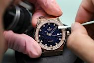 An employee of Swiss watchmaker Hublot works on a watch intended for the Chinese market. The question being mulled by famous Swiss watch brands is whether to create more specialty editions aimed at appealing specifically to the Chinese or instead simply wait for fast-shifting Chinese tastes to adapt to European fashion