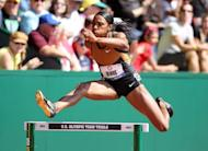 Lashinda Demus competes in the women's 400m hurdles at the US Olympic Track and Field Trials on July 1. Demus won the women's 400m hurdles in 53.98, becoming the second-fastest performer in the world this year behind Russia's Irina Davydova