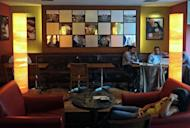 Customers sit at a Coffee Bean and Tea Leaf outlet in Mumbai in July 2012. Starbucks is betting on big returns as it seeks to lure an expanding legion of coffee lovers in India -- primarily a tea-drinking nation where lifestyle changes have spawned a booming market for cafes