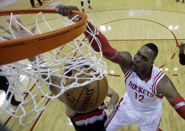 Houston Rockets' Dwight Howard (12) dunks during the first half in Game 2 of an opening-round NBA basketball playoff series against the Portland Trail Blazers Wednesday, April 23, 2014, in Houston