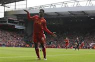 Liverpool's Daniel Sturridge celebrates after scoring his side's second goal during their English Premier League soccer match against Crystal Palace at Anfield in Liverpool, northern England October 5, 2013. REUTERS/Phil Noble