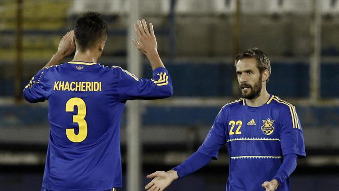 Ukraine's Devic and Khachiridi celebrate a second goal against the U.S. during their international friendly soccer match in Larnaca