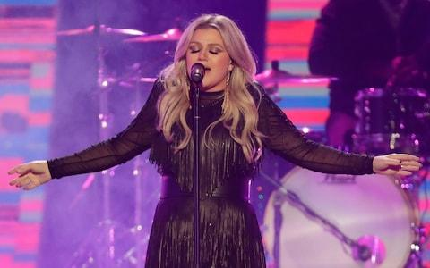 Kelly Clarkson will perform at this year's opening ceremony - Credit: AP