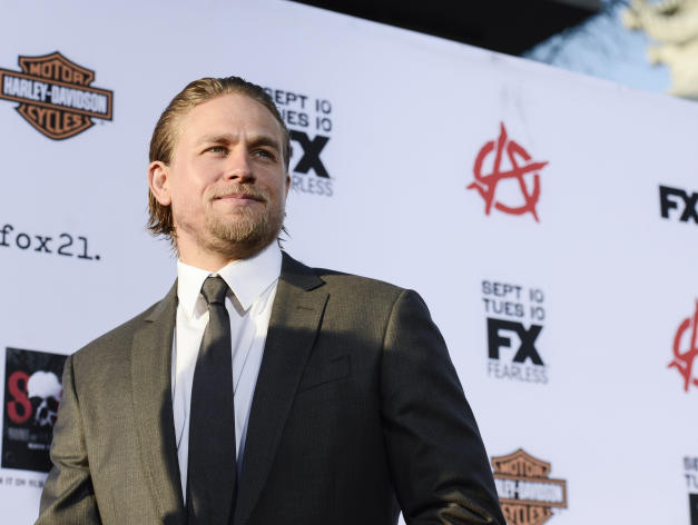 """Actor Charlie Hunnam arrives on the red carpet at the season six premiere screening of the television series """"Sons of Anarchy"""" at the Dolby Theatre on Saturday, Sept. 7, 2013 in Los Angeles. (Photo by Dan Steinberg/Invision/AP)"""