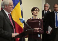 Russia's Ambassador to the U.N. Vitaly Churkin, second from right, listens as U.K. Ambassador to the U.N. Mark Lyall Grant, far left, speaks during a news conference after a private UN Security Council meeting on the Ukraine, Friday Feb. 28, 2014, in New York. (AP Photo/Bebeto Matthews)