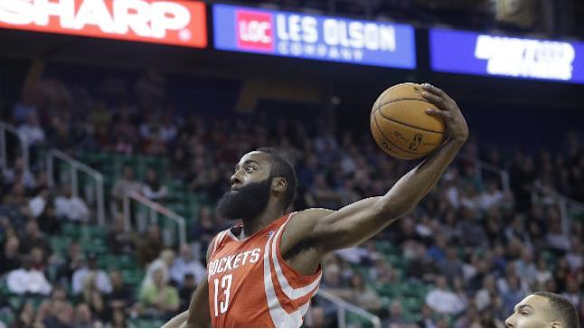Houston Rockets' James Harden (13) goes to the basket as Utah Jazz's Rudy Gobert (27), of France, looks on in the first half during an NBA basketball game Saturday, Nov. 2, 2013, in Salt Lake City. The Rockets defeated the Jazz 104-93
