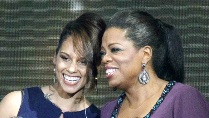 "FILE - This May 17, 2011 file photo shows singer Alicia Keys, left, and Oprah Winfrey during a taping of ""Surprise Oprah! A Farewell Spectacular,""  in Chicago. Keys announced Tuesday, July 10, 2012 that her organization Keep a Child Alive will pay homage to Winfrey at its Black Ball event on Nov. 1. Winfrey's humanitarian efforts include the building of schools in South Africa. (AP Photo/Charles Rex Arbogast, file)"