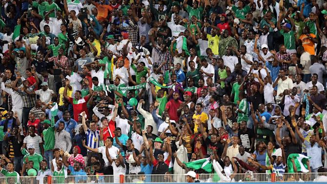 Nigeria fans celebrate after the team defeated Sweden in their semifinal soccer match of the World Cup U-17 at Rashid stadium in Dubai, United Arab Emirates, Tuesday, Nov. 5, 2013. (AP Photo)
