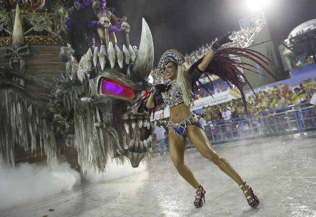 A performer from the Vila Isabel samba school parades during carnival celebrations at the Sambadrome in Rio de Janeiro, Brazil, Monday, Feb. 16, 2015. (AP Photo/Leo Correa)