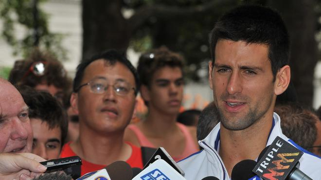 Novak Djokovic Of Serbia Speaks AFP/Getty Images