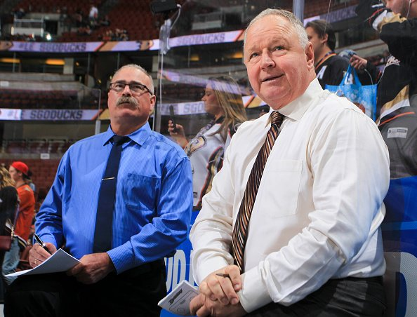 Randy Carlyle and assistant coach Paul MacLean of the Anaheim Ducks watch warmup before the game against the New Jersey Devils at Honda Center on November 17, 2016 in Anaheim, California. (Photo by Debora Robinson/NHLI via Getty Images)
