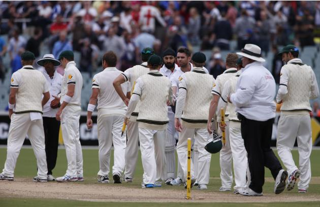 England's Anderson and Panesar shake hands with the Australia team after losing the second Ashes cricket test at the Adelaide Oval