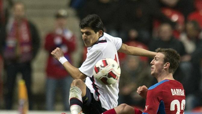 Tarik Elyounoussi from Norway, left, fights for the ball with Vladimr Darida from the Czech Republic, right, during  their friendly soccer match in Prague, Czech Republic, Wednesday, March 5, 2014. Match ended 2-2. (AP Photo,CTK/Michal Kamaryt)