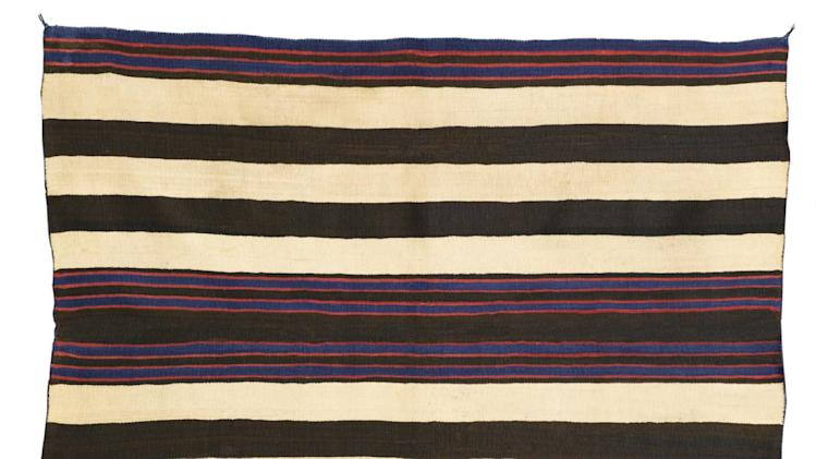 This undated photo provided by Sotheby's New York shows a  Navajo man's wearing blanket from the collection of Andy Williams. The late American crooner had a passion for Navajo blankets, assembling a museum-quality collection that's slated to be auctioned for more than $1 million next year. (AP Photo/Sotheby's)
