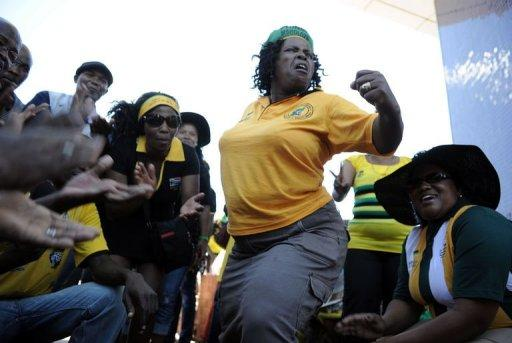 Supporters of South African President Jacob Zuma sing and dance outside the 53rd National Conference of the African National Congress (ANC) on December 17, 2012 in Bloemfontein. The race to see who leads the ANC -- and likely South Africa -- until the end of the decade neared an end Tuesday, as party voting closed and the results were being counted.