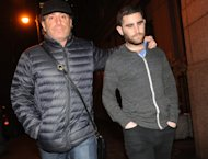 FILE - In this Jan. 27, 2014 file photo, Charlie Shrem, right, exits Manhattan federal court with an unidentified person, in New York. The New York Bitcoin operator is set to plead guilty, Thursday, Sept. 4, 2014, in a case stemming from the black market website Silk Road shutdown. (AP Photo/ Louis Lanzano, File)