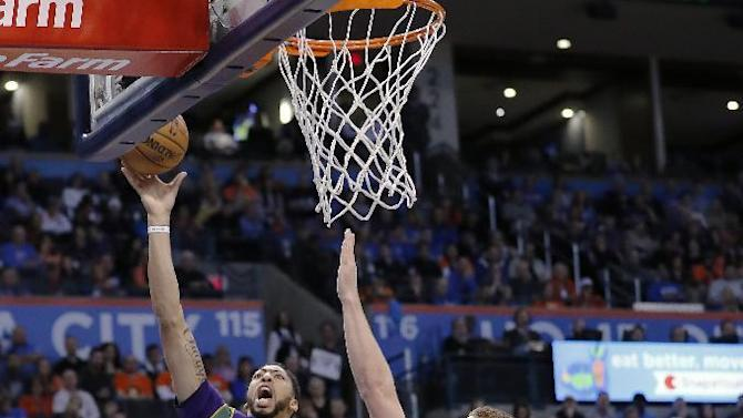 New Orleans Pelicans forward Anthony Davis (23) goes up for a basket as Oklahoma City Thunder forward Domantas Sabonis (3) defends during the first half of an NBA basketball game in Oklahoma City, Sunday, Feb. 26, 2017. (AP Photo/Alonzo Adams)