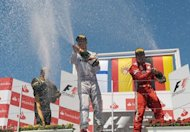 L to R: Second-placed Lotus F1 Team's Finnish driver Kimi Raikkonen, winner Ferrari's Spanish driver Fernando Alonso and third-placed Mercedes' German driver Michael Schumacher celebrate on the podium of the European Formula One Grand Prix at the Valencia Street Circuit in Valencia