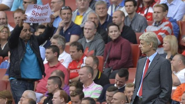 An Arsenal fan tells Arsene Wenger to open his wallet (Reuters)