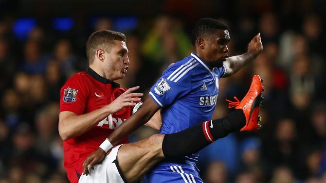 Chelsea's Eto'o is challenged by Manchester United's Vidic during their English Premier League soccer match at Stamford Bridge