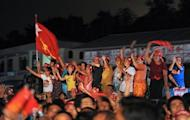 Supporters of Myanmar opposition leader Aung San Suu Kyi's National League for Democracy (NLD) celebrate outside the NLD headquarters in Yangon. Myanmar's opposition claimed a historic victory on Sunday for pro-democracy leader Suu Kyi in her first bid for a seat in parliament, sparking scenes of jubilation among supporters