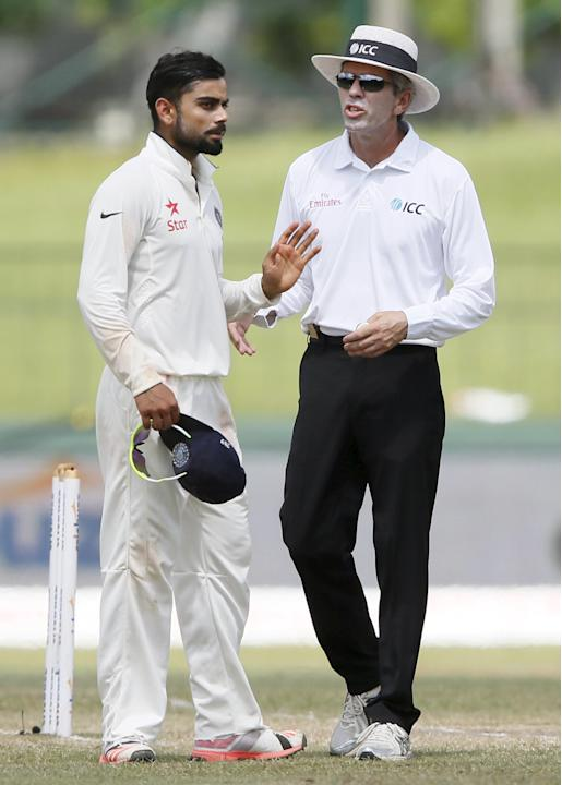 India's captain Kohli talks with umpire Llong during the final day of their third and final test cricket match against Sri Lanka  in Colombo