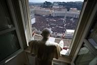 "Pope Benedict XVI leads the Angelus prayer from the window of his appartments on February 24, 2013 at the Vatican. He delivered an emotional last Sunday prayer in St Peter's Square, saying God had told him to devote himself to quiet contemplation but assuring he would not ""abandon"" the Church"