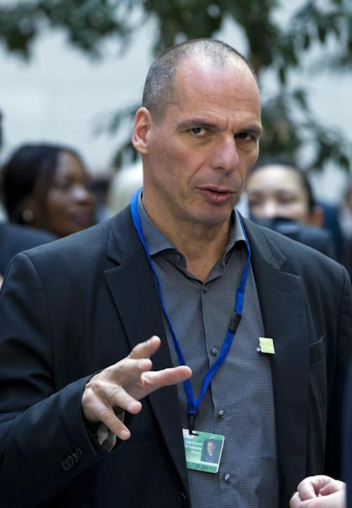 Greek Finance Minister Yanis Varoufakis gestures as he attends the International Monetary Fund IMF Governors group photo, at the World Bank-International Monetary Fund annual meetings in Washington, S