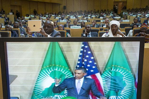 People look on as U.S. President Barack Obama delivers a speech to the African Union, Tuesday, July 28, 2015, in Addis Ababa, Ethiopia. On the final day of his African trip, Obama is focusing on econo