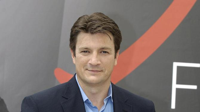 """FILE - In this June 13, 2012 file photo, Canadian actor Nathan Fillion poses during a photocall at the 2012 Monte Carlo Television Festival, in Monaco. Fillion starred in the series """"Firefly,"""" which is marking the 10th anniversary of its brief TV run with """"Firefly: Browncoats Unite,"""" a special airing 10 p.m. EST Sunday, Nov. 11, on the Science Channel. (AP Photo/Lionel Cironneau, File)"""