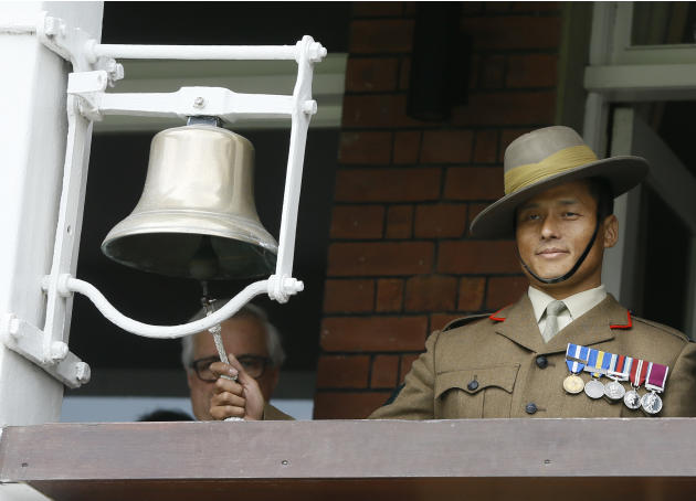 Gurkha Major Tolbahadur Khamcha rings the bell to signal five minutes until the start of play, on the third day of the first Test match between England and New Zealand at Lord's cricket ground in