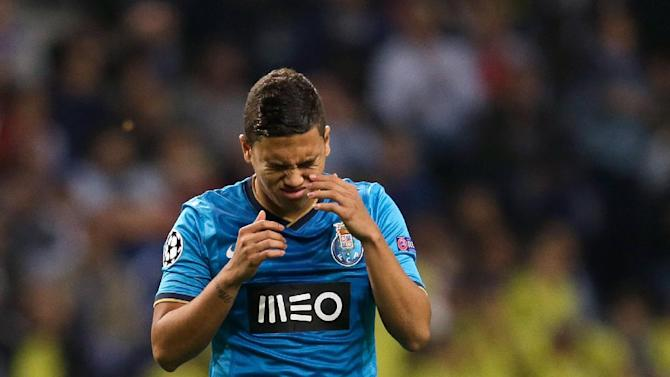 Porto's Juan Quintero reacts after missing a shot at goal during the Champions League group G soccer match between FC Porto and Atletico de Madrid Tuesday, Oct. 1, 2013, at the Dragao stadium in Porto, northern Portugal