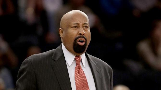 New York Knicks' head coach Mike Woodson reacts during the first half of the NBA basketball game against the Cleveland Cavaliers at Madison Square Garden, Sunday, March 23, 2014, in New York. The Cavaliers defeated the Knicks 106 to 100