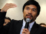 Philippine boxing icon Manny Pacquiao, pictured here on March 26, has combined his new-found religious fervour with his training for an upcoming fight, holding bible-reading sessions after daily workouts