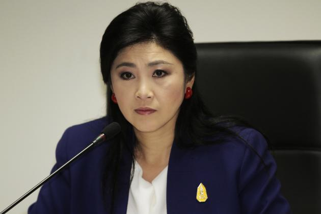 Prime Minister Yingluck Shinawatra attends her cabinet economic meeting at the office of the Permanent Secretary of Defense in Bangkok