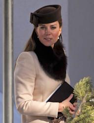 Catherine, Duchess of Cambridge attends the wedding of Laura Bechtolsheimer and Mark Tomlinson at the Protestant Church in Arosa, Switzerland on March 2, 2013 -- Getty Premium