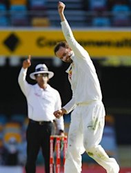 Australian bowler Nathan Lyon punches the air after claiming the wicket of South African batsman Jacques Rudolph on day five of their first Test. Rudolph ultimately went lbw to Lyon for 11 heading into the final hour