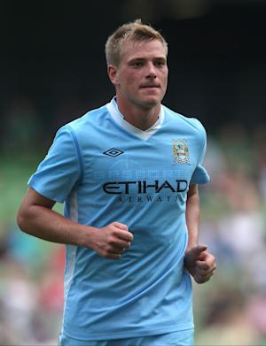 John Guidetti has committed his future to Manchester City